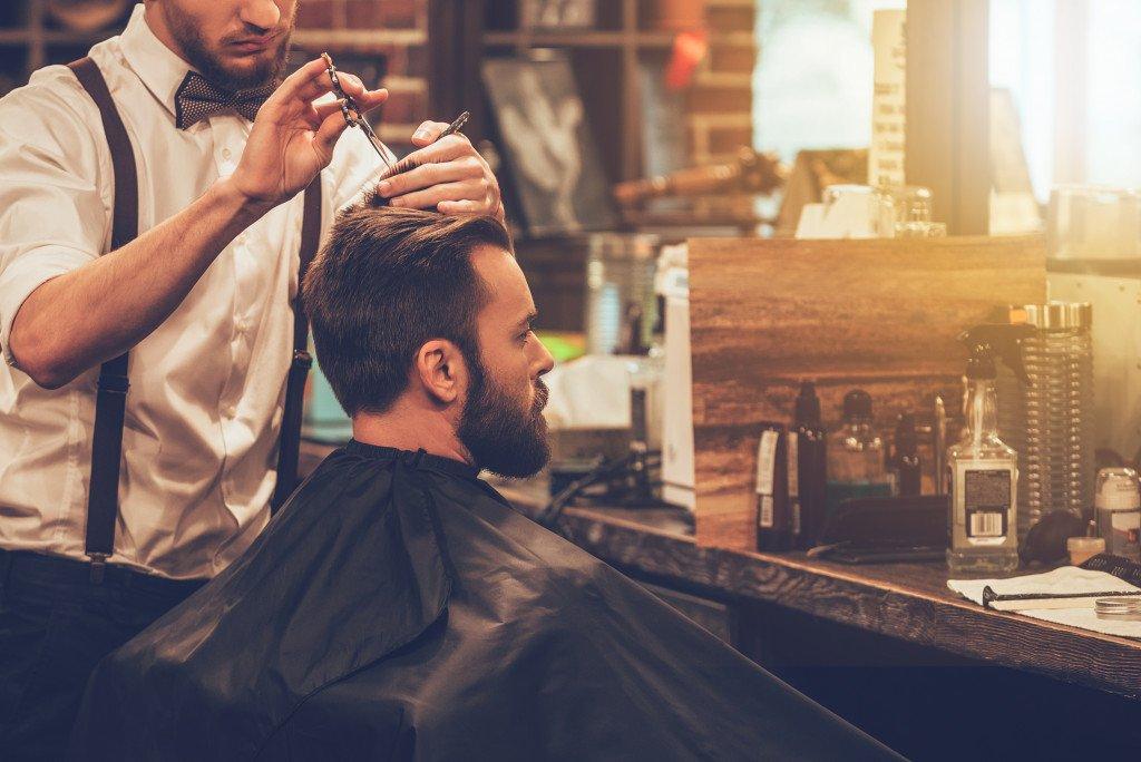 man getting his hair cut