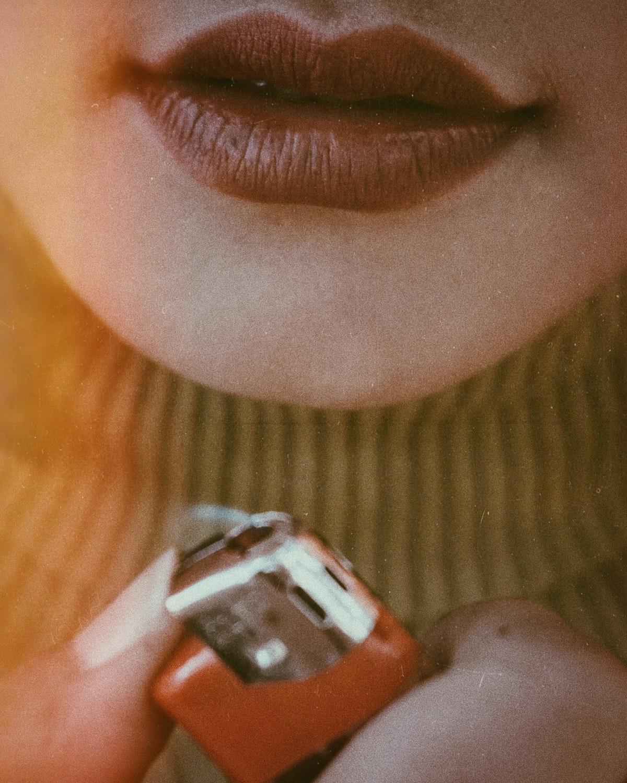 woman holding a lighter