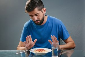 man with eating disorder