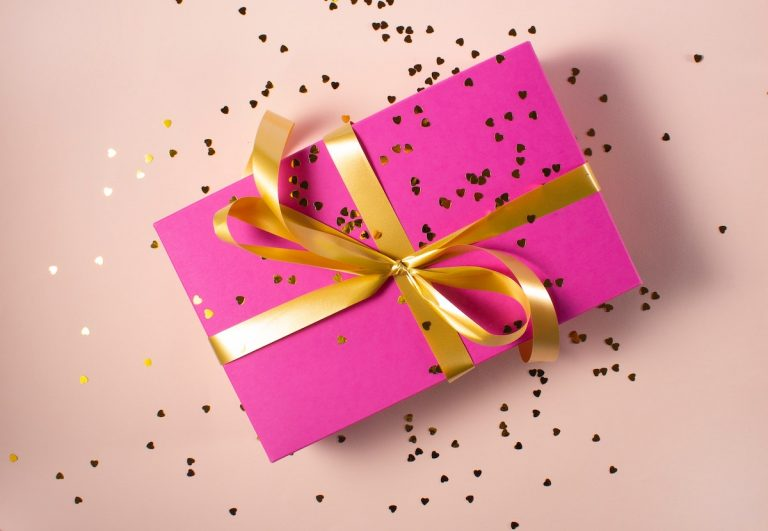 pink gift wrap with gold ribbon